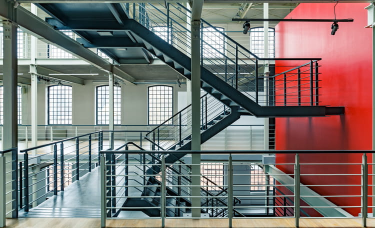 industrial interior with metal staircase with red wall