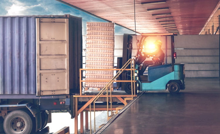 Lorry unloading at warehouse