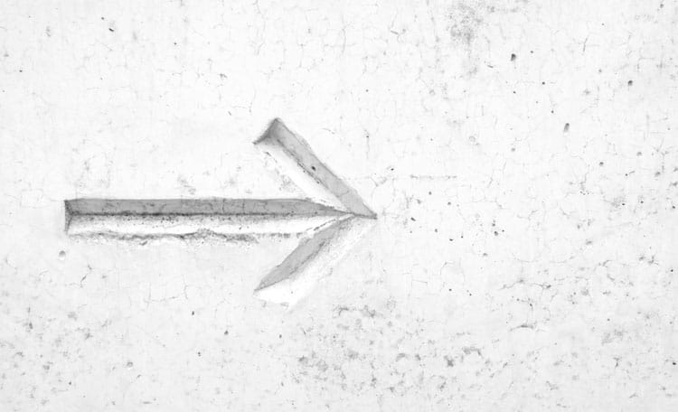 arrow engraved in concrete
