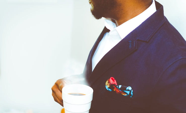 smartly dressed man with coffee