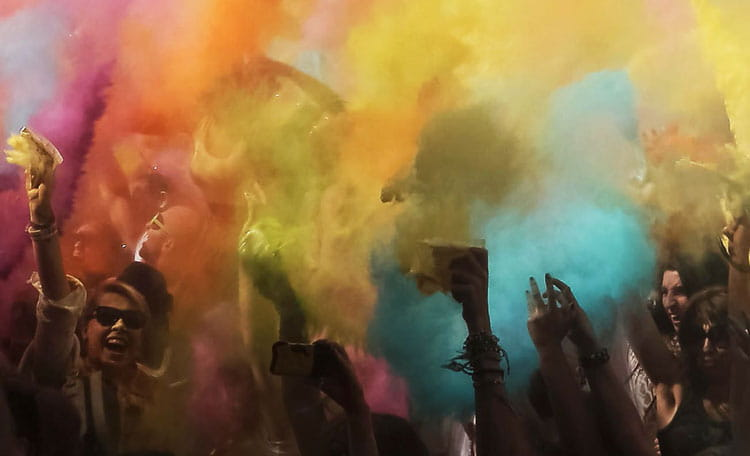 People enjoying a colour powder party